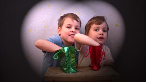 children with present bags Stock Video Footage
