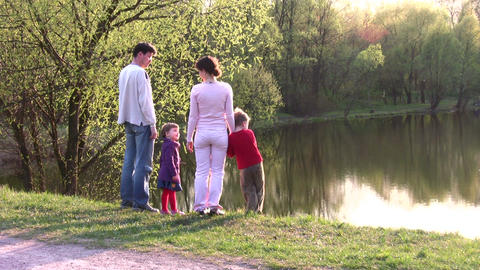 family on spring pond Stock Video Footage