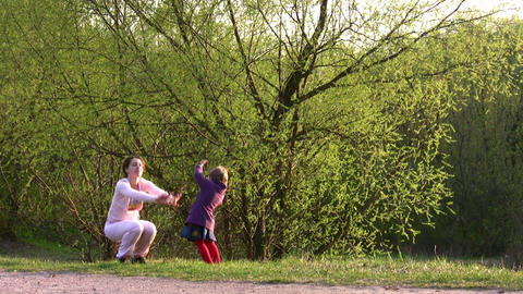 mother with girl play in park Stock Video Footage