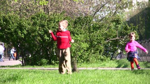 running children in park Stock Video Footage