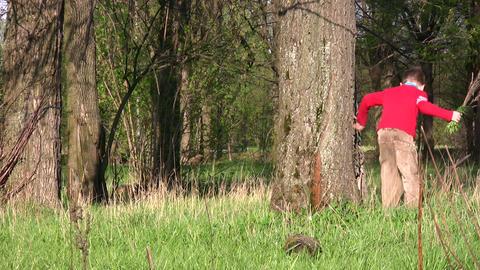 children run around tree Stock Video Footage