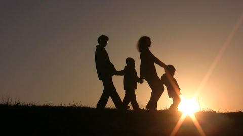 walking family sunset Stock Video Footage