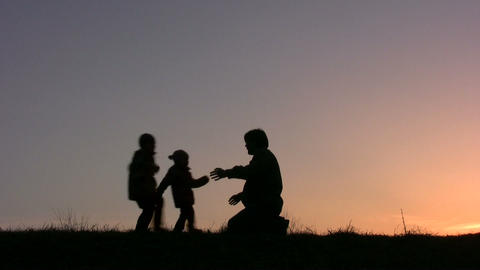 children run to father sunset Stock Video Footage