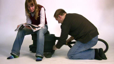 couple with vacuum cleaner Stock Video Footage