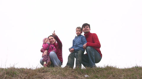 family of four on meadow Stock Video Footage