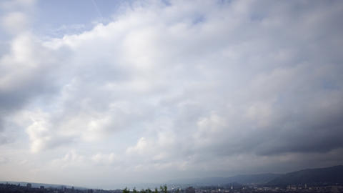 Clouds above a city and a lake (timelapse) Stock Video Footage