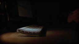 Typing in dark room Stock Video Footage