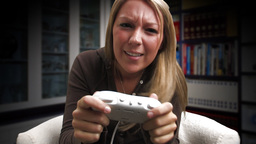 Woman Playing Electronic Game (Losing) Stock Video Footage