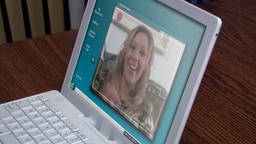 Girl waving in laptop screen Stock Video Footage