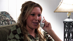 Girl chatting on telephone Footage