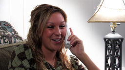 Girl chatting on telephone Stock Video Footage