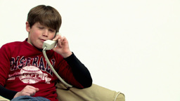 Boy using telephone panning HD Stock Video Footage