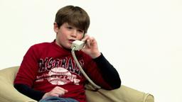 Boy using telephone panning HD Stock Video Footage