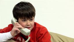 Boy chatting on telephone HD Footage