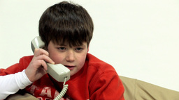 Boy chatting on telephone HD Stock Video Footage