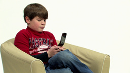 Boy using handphone HD Footage