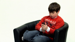 Boy on black couch HD Stock Video Footage