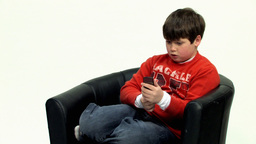 Boy on black couch HD Footage