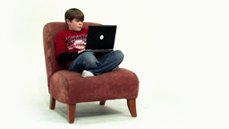Child on couch angle view HD Stock Video Footage