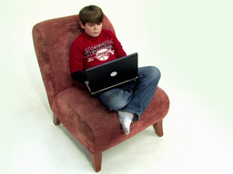 Boy on couch use laptop Stock Video Footage