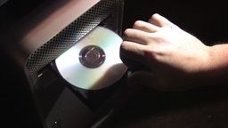 Inserting Compact Disc Into Computer (Slow version) Stock Video Footage