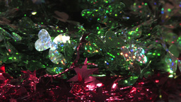 Sparkling Festive Decoration Wires With Green Leaves And Pink Star Patterns Footage