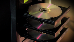 Computer Tower Ejecting Compact Discs (CDs) Footage