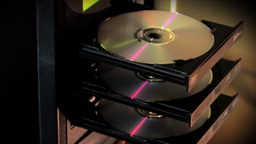 Computer Tower Ejecting Compact Discs (CDs) Stock Video Footage
