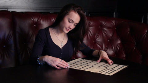 Girl Studying The Menu Footage