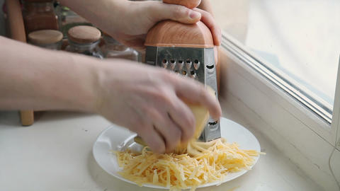 Man grating cheese for pizza Footage