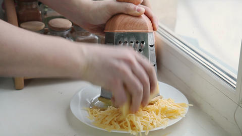 Man grating cheese for pizza Stock Video Footage