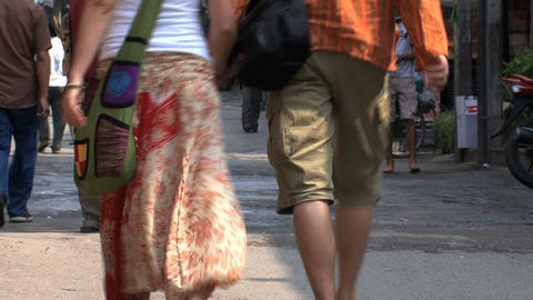 tourists walking hand in hand through thamel, Kathmandu Stock Video Footage