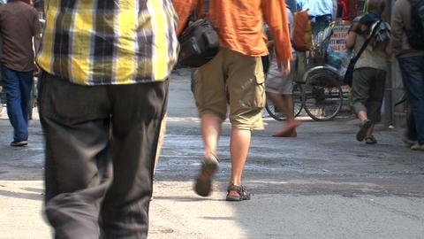 tourists walking hand in hand through thamel, Kathmandu Stock Video Footage