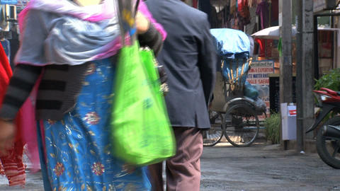 Colorful Women walking in the street of Thamel Stock Video Footage