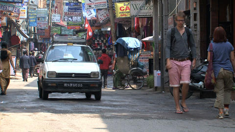 Taxis in the street of Thamel Kathmandu Stock Video Footage