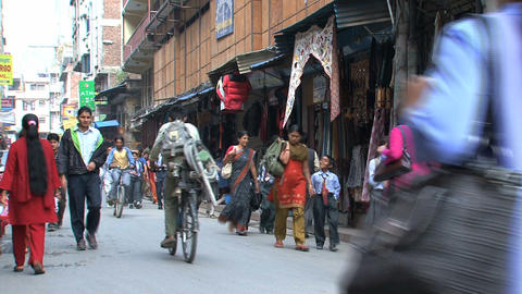 Busy street with school kids in Thamel Stock Video Footage