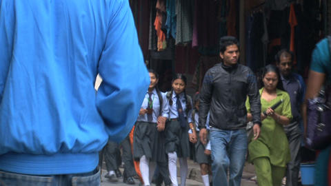 Busy street with school kids Stock Video Footage