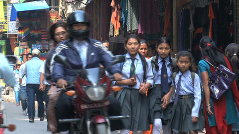 Busy street with school kids Footage