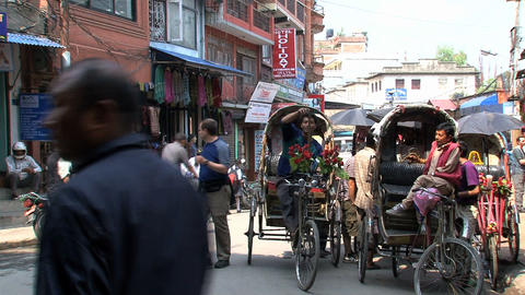 Bike taxis in the street of Kathmandu Stock Video Footage