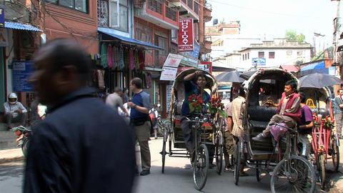 Bike taxis in the street of Kathmandu Stock Video Footage