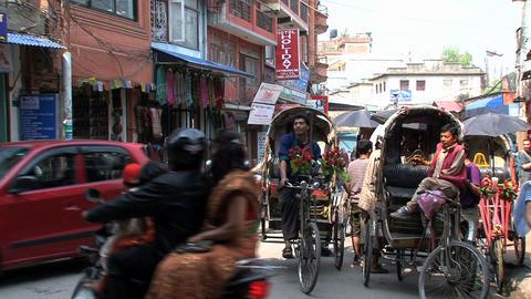 Bike taxis in the street of Kathmandu Footage