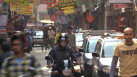 Narrow street with taxis, bike taxis, scooters and Stock Video Footage