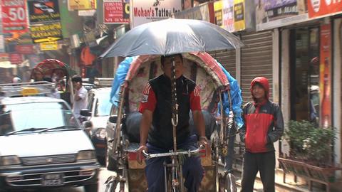 Bike taxi in the street of Thamel Kathmandu Stock Video Footage