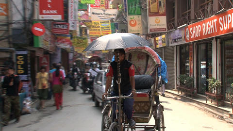 Bike taxi in the street of Thamel Kathmandu Footage