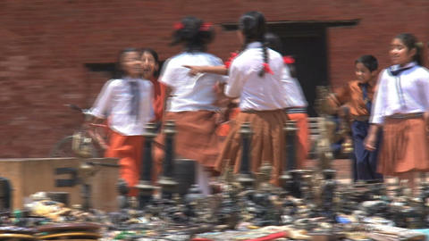 School kids playing at the market Stock Video Footage