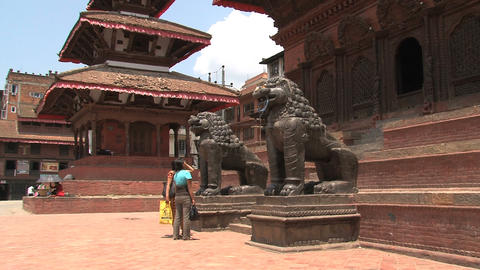 People looking and walking away from Lions statue Stock Video Footage