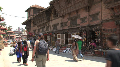 Tourism stores and people passing by Stock Video Footage