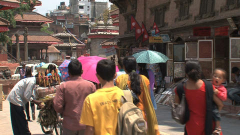 People with colorful clothes walking Stock Video Footage
