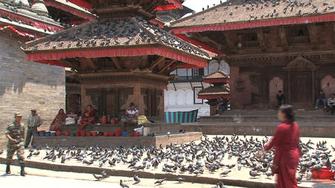 Local people and tourists passing by a temple at D Stock Video Footage