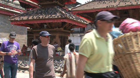 Local people and tourists passing by a temple at D Footage